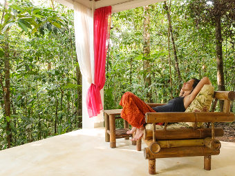 Woman on the chair. Relaxation in beautiful house in the jungle.. Photo: © Thomas Räse