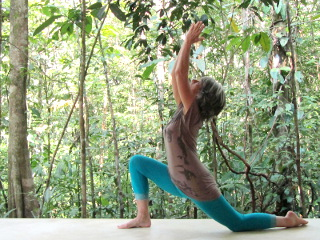 Photo of Yoga Asana with Doris on the terrace in the fresh air in the rainforest.