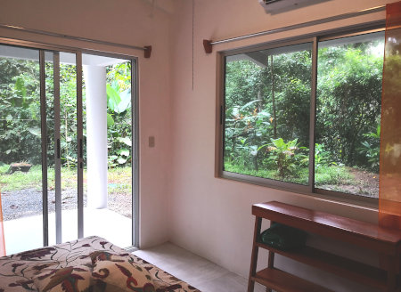 Photo of a room from the inside with patio door and window by Casita Hoja Verde
