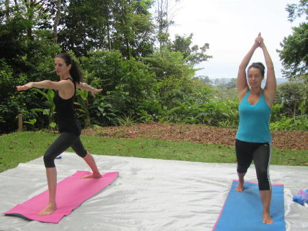 Photo of 2 women in the practice of yoga in the park in Portasol.